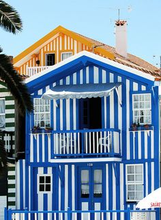 Blue & White Striped Beach House. LOVE!