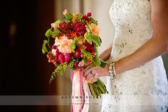 This photo highlights not only the bride's stunning dress but also her gorgeous bouquet. Photography: Autumn Burke Photography
