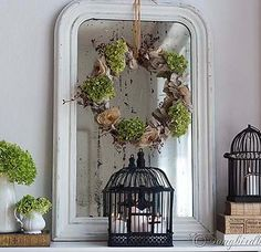 Fall mantel decoration with a vintage French mirror and a homemade wreath. The hydrangea flowers and the birdcages add a romantic touch. See more pictures at http://www.songbirdblog.com