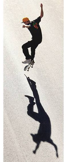 The Year in Photos 2011 - Skateboarder's Shadow by Jeff Hinckley. Skateboarder O.J. Hays pulls off a trick in Downtown Columbus near the Statehouse on a really bright August day.