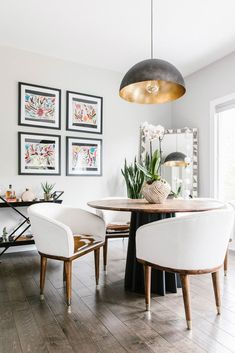 grid gallery wall and modern-eclectic decor in the dining room