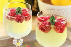 "6 Brunch Drinks To Try -- This Limoncello Prosecco Cooler w/ Raspberry ""ice cubes"" sounds delicious and as simple to make as a Mimosa -- 2 parts Limoncello to 4 parts chilled sparkling wine, one or two muddled sprigs of mint and some frozen raspberries!"