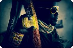 """For his series """"Ghosts,"""" South African artist Ralph Ziman photographed Zimbabwean street vendors yielding handmade replicas of AK-47s, adorned in traditional Shona style beading."""