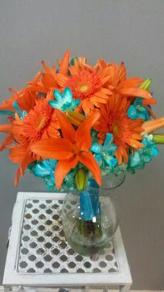 Miami Blue Bouquet: Orange Tiger Lilies,  Orange Gerber Daisies,  Teal Hydrangea,  Miami blue Dendrobium Orchids.  Designed by Ms Scarlett's Flowers.