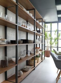Connecting practical #storage spaces with the Emotions columns and open #shelving #InteriorDesign #furniture #deco #Porcelanosa