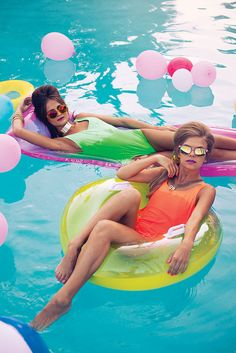 Who says you have to be in your slops and trackies to relax? Love this picture of these girls staying stylish in the pool and love the neon look this summer! | #MonsoonAccessorizeHoliday #Monsoon #Accessorize #Holiday #SummerStyles #Destination #TravelInspiration #Pool #Neon
