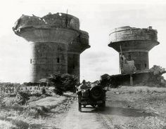 These three enormous flak towers guarded a German Marine base near Angers France. Each tower would have been armed with several large caliber and small caliber anti-aircraft guns including the much feared 88 mm Flak gun. The towers were destroyed by Allied air attacks as General Pattons 3rd Army advanced East.