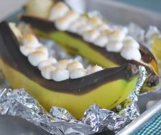 Banana Boat  Did these in camp fire when I was a kid.  Now as a treat every once in awhile I do them in the oven.  They kick smore butt!  Of course I use 3 to 4 times as much chocolate chips and marshmallows! I cook at 350 then broil at the end to crisp up the marshmallows.  SOOOOOOOOOOO YUMMY!!!!!!