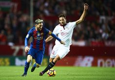 Lionel Messi Photos Photos - Lionel Messi of FC Barcelona (L) competes for the ball with Franco Vazquez of Sevilla FC (R) during the match between Sevilla FC vs FC Barcelona as part of La Liga at Ramon Sanchez Pizjuan Stadium on November 6, 2016 in Seville, Spain. - Sevilla FC v FC Barcelona - La Liga