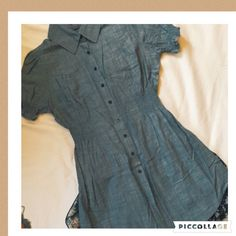 "Capped Sleeve Top This super cute blouse has a wide elasticated waist, pleated shoulder capped sleeves and button closure. It is blue denim coloured. Measures approx. 30"" from shoulder to bottom hem. It has seen very little wear and looks like new. Poetry Tops Tunics"