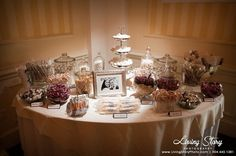 Candy table favor table! Love the glass jars, wish there was more color. Either the cloth or the candy