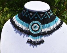 This is absolutely stunning and elegant necklace made with high quality seed beads in black/blue/white colors.  The beaded length of the necklace measures 13 long but can be extended to desirable length; 4 long in the center. 100% Handmade  Thank you for visiting my shop