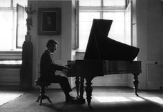 Leonard Bernstein at Chopin's piano in Warsaw.