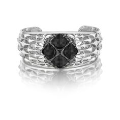 A true statement maker! With a combination of clean silver and black silver with four cushion cut black onyx stones in a central cluster this cuff has it all! Worn with your favorite LBD or skinny jeans and a blazer, this innovative and dynamic design is sure to please any Tacori girl.