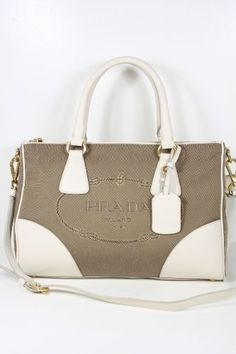 This authentic Prada Beige Fabric and White Leather BL0833 Handbag comes directly from designer boutiques - Prada Beige Fabric and White Leather - Top