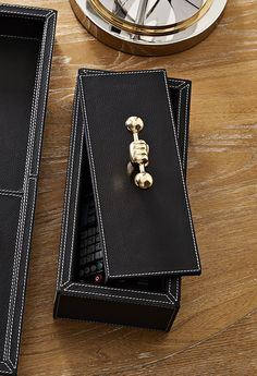 The Jonathan Adler Barbell Leather Box is a great gift for the groom. it is masculine, yet mature.