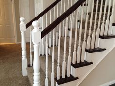 Two toned stairs with wood and carpeting