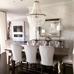 Z Gallerie Waterloo Dining Chairs. Hand applied brushed nickel nail head trim and rich + regal tufting make this chair an exquisite dining room addition.  Photo via @allisonlambert_1 also features Z Gallerie Omni Buffet + mirror.