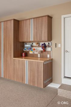 Stylish Garage Cabinets for Your Modern Parking Space: Impressive Garage Cabinets Design In Home Design With Light Brown Wooden Cabinets And. Contemporary Sheds, Garage Storage Cabinets, Modern Garage, Custom Garages, Multipurpose Room, White Doors, Wooden Cabinets, Elegant Homes, Cabinet Design