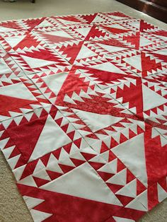 Beautiful red and white quilt made with Go!