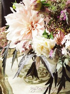 bouquet of dahlias and elderberies on a table
