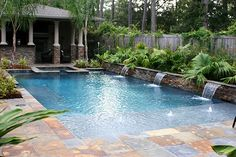 Plants & water feature on one side of pool