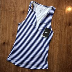 Blue Stripped Nike Dri-Fit Tank NWT! The stripes are blue and white. The neckline kind of curves down into a v. Nike Tops Tank Tops