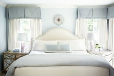 Kara Cox Interiors: Chic blue bedroom with blue paint color, white sunburst mirror and blue gray linen ...