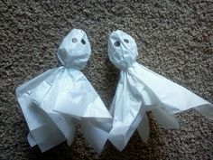 Homemade floating ghosts! made from plastic bottles with fishing line, washers & tissue paper.