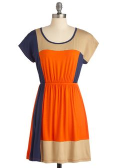 Complementary Colorblock Dress-Pair it with layered gold necklaces, a neutral belt, and woven wedges for a look that's saturated in style.