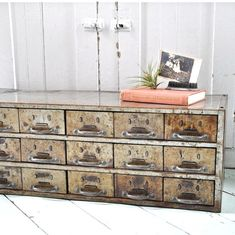 I want to find an industrial cabinet like this wide but not tall to place on the sofa table to keep mail and such