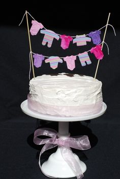 WAY cute for the next baby shower I host. Ahem... who's it going to be?? Girl Baby Shower - Cake Banner. $16.00, via Etsy.