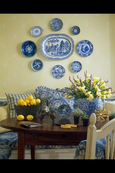 Banquette Dining in Blue and White with Yellow Accents. Great Wall Plate Display.