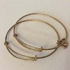 Alex and Ani Set 2 Textured Fillers Expand Singles Gold tone, pre owned, good pre loved conditions, see pictures closely please. Signs of normal use as pictured. Alex & Ani Jewelry Bracelets