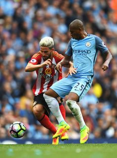 Fabio Borini of Sunderland and Fernandinho of Manchester City battle for possession during the Premier League match between Manchester City and Sunderland at Etihad Stadium on August 13, 2016 in Manchester, England.
