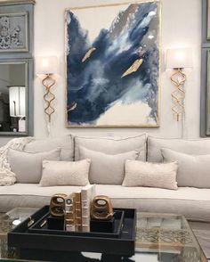 Bare walls? Dress them up! Use art to decorate and balance a room. In this photo the art creates a focal point, adds color and interest to an otherwise neutral space, and unites the different gold finishes used throughout