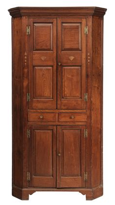 Southern Chippendale Inlaid Walnut Paneled Corner Cupboard probably Virginia, late 18th century, single case construction, panel doors with shelved interiors, two bellflower, fan and line inlaid dovetail drawers, yellow pine secondary, 85-1/2 x 44 x 21 in.