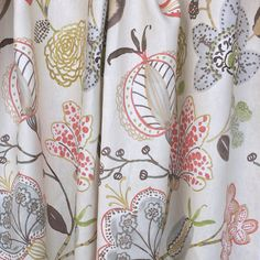 A pretty, large scale, hand drawn floral fabric with the softest palette of coral pink, soft blue grey, leaf green, earthy brown and golden rod yellow on a soft