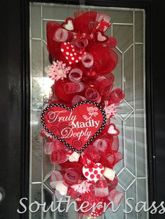 This Valentines Swag is made with layered loops of red deco mesh and accented with a red/white pattern deco mesh spirals, red sheer My Funny Valentine, Valentine Day Wreaths, Valentines Day Hearts, Valentine Day Love, Valentines Day Decorations, Valentine Day Crafts, Holiday Crafts, Valentine Ideas, Holiday Wreaths
