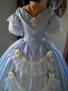 Light blue Civil era ballgown, with lace, flowers, beaded trim