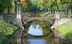 """""""This is an old iron bridge crossing a canal in a park near Catherine the Great's Palace in Pushkin, Russia, near St. Petersburg."""""""