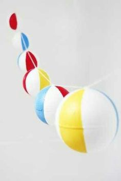 Beach ball decor - fishing line wrapped around nozzles