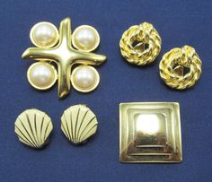 No time wasted searching when your accessories come together in a stylish mix of faux pearls, golden shells and abstract designed earrings and brooch 4 piece set.