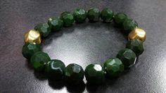 Check out this item in my Etsy shop https://www.etsy.com/listing/268579201/green-and-gold-bracelet