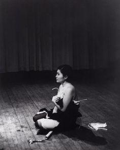 Yoko Ono. <i>Cut Piece</i>. 1964. Performed by Yoko Ono in <i>New Works of Yoko Ono</i>, Carnegie Recital Hall, New York, March 21, 1965. Photograph by Minoru Niizuma. © Minoru Niizuma. Courtesy Lenono Photo Archive, New York
