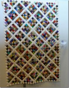 I just love postage stamp quilts.  This one will be favorite.