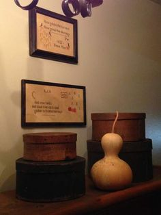 old pantry boxes, gourd and samplers in hallway