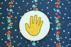 Fabric Handprint... great gift idea for the Grandparents.  Eventually, it would be cool to have an entire quilt with the kids handprints over the years.