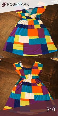 Colorful dress Colorful dress with 2 side pockets and dress scoops down in the back.  Cover photo is the back of the dress Dresses Midi