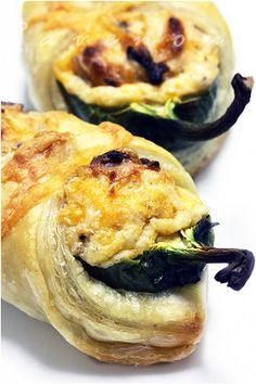 Jalapeno Poppers in a Blanket - jalapenos - 8 oz. light cream cheese - finely shredded Sharp cheddar or Monterrey jack cheese - 4 cloves of roasted garlic - bacon - puff pastry sheets